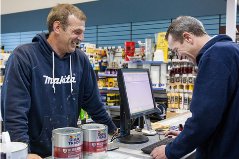 Man purchasing paint at a Brewers checkout