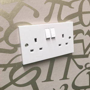 Take care when wallpapering around sockets.