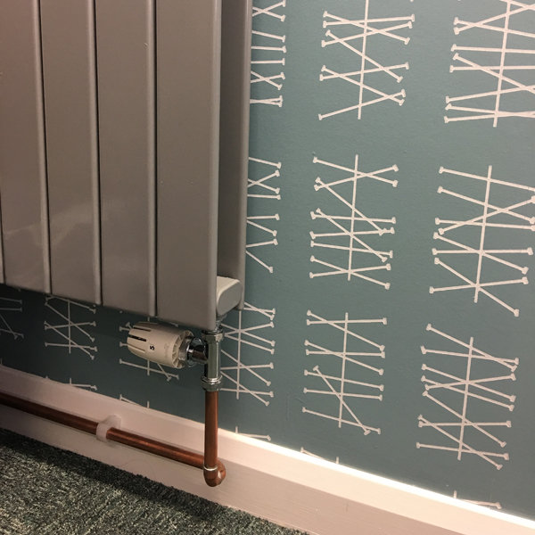 Wallpapering around a radiator