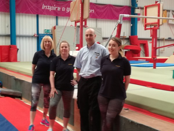 Brewers Northampton branch manager Stuart Bell with the NCAAC Gymnastics coaches