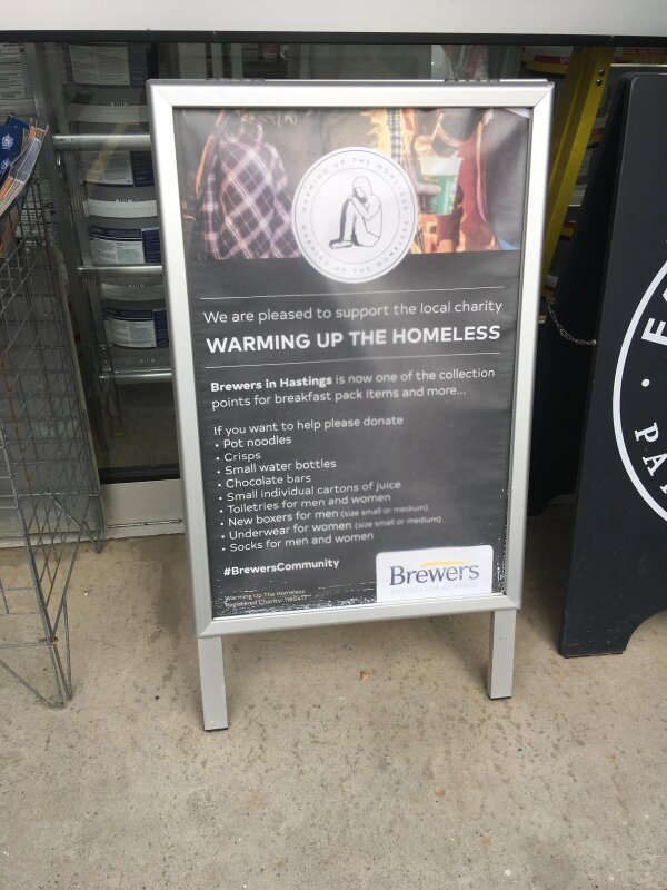 Warming up the Homeless poster outside Brewers Hastings store
